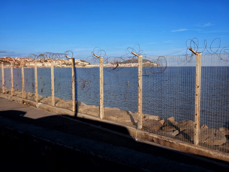 The fenced border crossing to the Moroccan city of Ceuta. Photo: Michael Mortimer